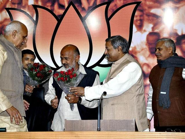 Expelled-BSP-ministers-Babu-Singh-Kushwaha-R-and-Badhshah-Singh-join-BJP-in-the-presence-of-BJP-National-Vice-President-Vinay-Katiyar-at-Party-office-in-New-Delhi-on-Tuesday-BJP-Uttar-Pradesh-state-unit-chief-Surya-Pratap-Shahi-L--is-also-seen-in-this-picture-PTI-Photo