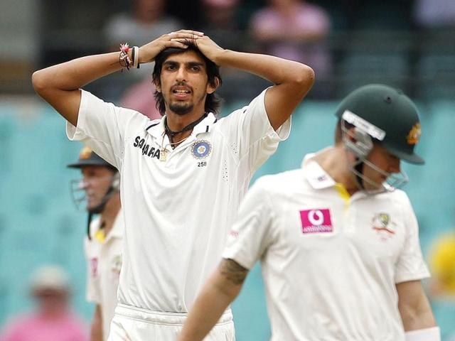 India-s-Ishant-Sharma-L-rolls-on-the-ground-after-attempting-to-field-a-shot-from-Australia-s-Ricky-Ponting-during-the-second-cricket-test-match-at-the-Sydney-Cricket-Ground-Reuters