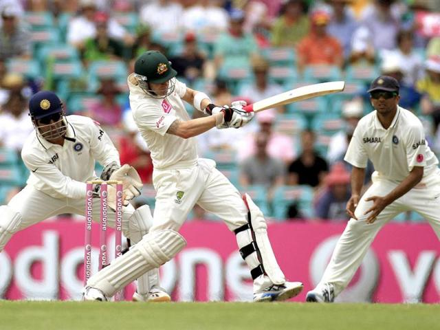 MS-Dhoni-left-and-Rahul-Dravid-right-prepare-to-field-as-Australia-s-Michael-Clarke-pulls-the-ball-on-the-third-day-in-their-cricket-test-match-at-the-Sydney-Cricket-Ground-in-Sydney-AP-Photo