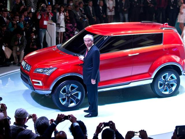 Managing-director-and-CEO-Maruti-Suzuki-India-S-Nakanishi-poses-with-the-new-XA-Alpha-concept-SUV-car-during-the-2012-Auto-Expo-in-New-Delhi-AFP-Manan-Vatsyayana