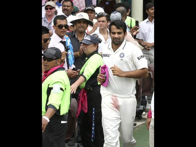 Zaheer-Khan-runs-on-the-field-holding-a-McGrath-Foundation-pink-cap-on-the-third-day-of-the-second-Test-match-at-the-Sydney-Cricket-Ground-in-Sydney-Australia-AP-Photo-Rob-Griffith