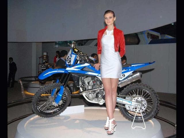 A model poses with Honda's sports bike at Auto Expo 2012 at Pragati Maidan, in New Delhi. Agency photo