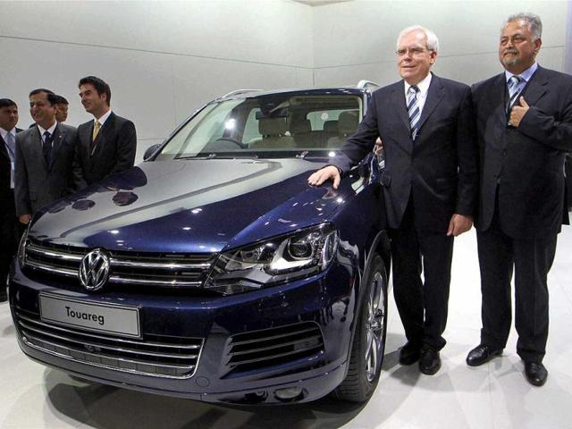 Ulrich-Hackenberg-2nd-R-board-member-of-management-of-Volkswagen-and-other-officials-pose-near-the-company-s-Touareg-car-at-the-11th-Auto-Expo-2012-at-Pragati-Maidan-in-New-Delhi-PTI-Photo-by-Kamal-Singh