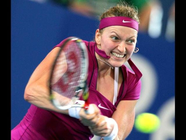 Petra-Kvitova-of-the-Czech-Republic-hits-a-return-against-Caroline-Wozniacki-of-Denmark-during-their-women-s-singles-session-10-match-of-the-Hopman-Cup-Tennis-Tournament-in-Perth-AFP-Photo-Tony-Ashby