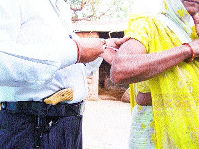 An-unqualified-paramedic-who-goes-on-home-calls-in-towns-or-villages-injecting-an-intra-muscular-painkiller-into-a-patient-at-a-village-in-Etah-He-keeps-a-revolver-tucked-into-in-his-belt-all-the-time-when-he-is-out-Photo-HT-Pankaj-Jaiswal