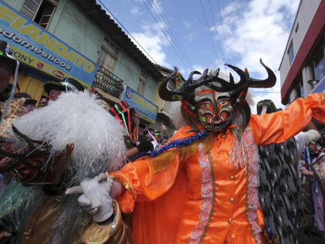 A-dancer-performs-Diablada-or-Dance-of-the-Devils-on-the-streets-of-Pillaro-133-km-south-of-Quito-Reuters-Photo