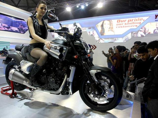 A model poses with Yamaha motorcycle at AutoExpo 2012 at Pragati Maiden in New Delhi. HT Photo / M Zhazo