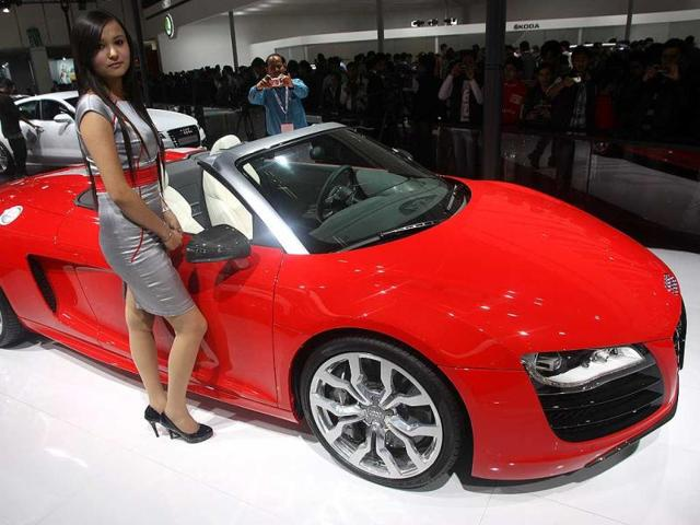 A model poses with an Audi car at Auto Expo 2012 at Pragati maiden in New Delhi on Saturday. HT Photo / M Zhazo