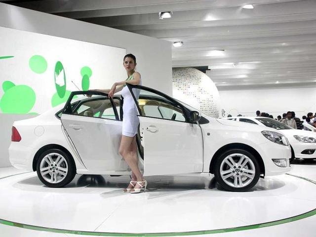 A model poses with Skoda Rapid at Auto Expo 2012 at Pragati Maiden in New Delhi. HT Photo / M Zhazo