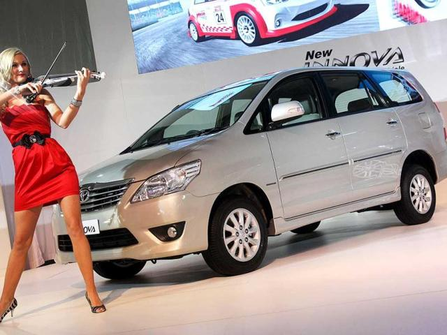 A model performs to showcase car at Toyota pavilion at Auto Expo 2012 at Pragati Maiden in New Delhi. HT Photo / M Zhazo