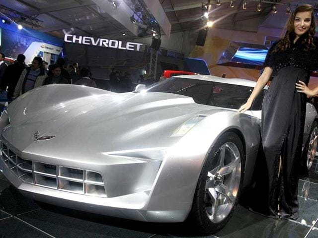 A model poses with Chevy Concept car at Auto Expo 2012 at Pragati Maiden in New Delhi. HT Photo / M Zhazo