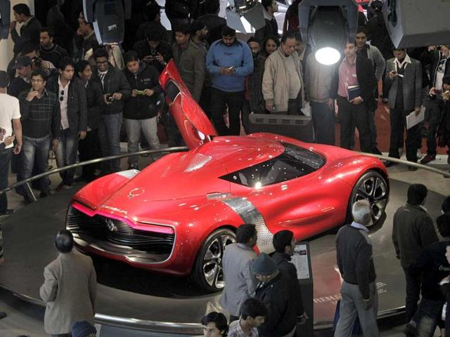 Enthusiasts look at Renault's electric concept car Dezir during a press preview of Auto Expo 2012 at Pragati Maidan in New Delhi. AP Photo / Manish Swarup