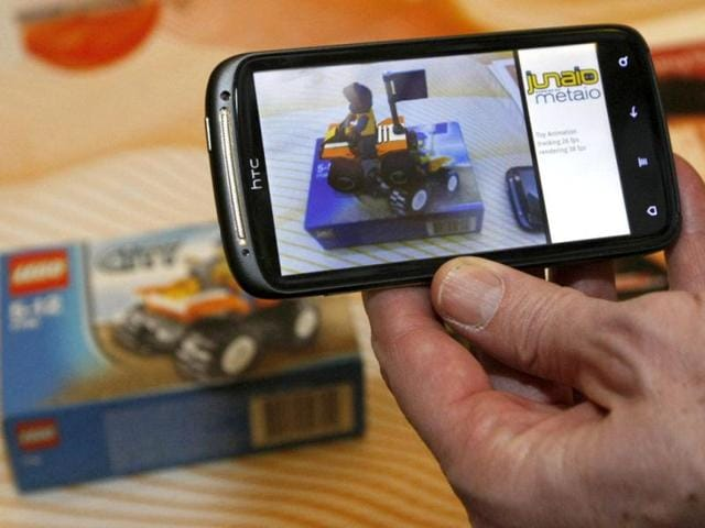 A-HTC-smartphone-with-a-ST-Ericsson-Nova-A9500-application-processor-chip-is-shown-at-the-Consumer-Electronics-Show-opening-event-in-Las-Vegas-January-8-2012-The-chip-runs-augmented-reality-applications-such-as-the-demonstration-showing-the-contents-in-the-box-which-can-be-seen-in-the-background-REUTERS