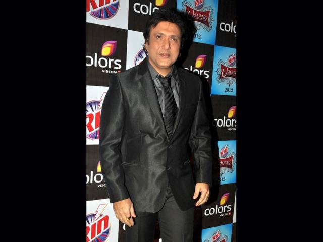 Man-in-black-Govinda-s-suit-has-extra-shine
