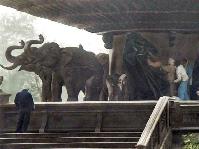 Employees-at-National-Dalit-Prerna-Sthal-cover-statues-of-elephants-following-Election-Commission-orders-in-Noida-PTI