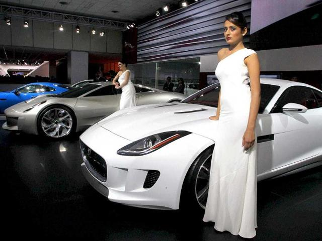A-model-poses-with-a-concept-car-foreground-on-display-at-a-pavilion-at-11th-Auto-Expo-2012-at-Pragati-Maidan-New-Delhi-PTI-Photo-by-Atul-Yadav