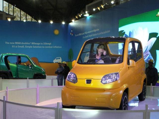 A-model-in-the-Bajaj-RE60-small-car-at-the-Bajaj-Auto-pavilion-at-Auto-Expo-2012-in-New-Delhi-HT-Photo-Sonu-Mehta