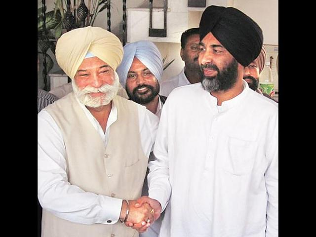 Former-Punjab-deputy-speaker-Bir-Devinder-Singh-left-along-with-Manpreet-Badal-HT-Photo