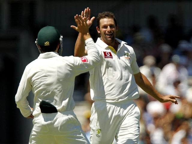 Sachin-Tendulkar-acknowledges-spectators-as-he-leaves-the-field-after-being-dismissed-by-Australia-s-captain-Michael-Clarke-during-the-second-cricket-Test-at-the-Sydney-Cricket-Ground-Reuters