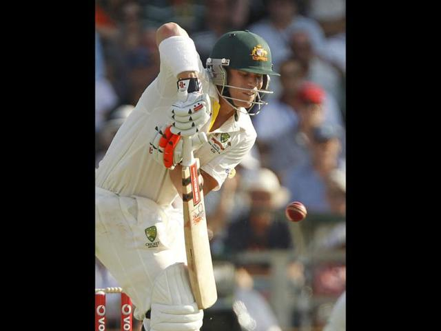 David-Warner-of-Australia-celebrates-reaching-100-runs-during-the-third-cricket-Test-match-against-India-at-the-WACA-in-Perth-Reuters-Photo