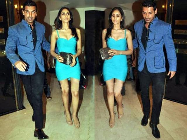 John Abraham was spotted with his rumoured girlfriend Priya at the Standard Chartered Marathon Bash hosted by Kingfisher. While John looks handsome in his blue-black attire, the investment banker outshines him in her short blue one-piece.