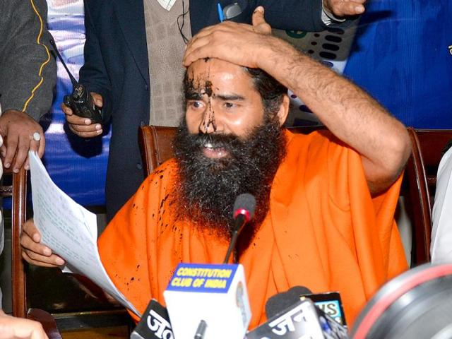 Baba-Ramdev-with-his-face-smeared-with-black-ink-reacts-during-a-press-conference-on-black-money-at-Constitution-Club-in-New-Delhi-HT-Photo-Virendra-Singh-Gosain