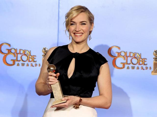 Kate-Winslet-poses-with-her-award-for-best-performance-by-an-actress-in-a-mini-series-or-motion-picture-made-for-television-for-Mildred-Pierce-backstage-at-the-69th-annual-Golden-Globe-Awards-in-Beverly-Hills-California-Reuters