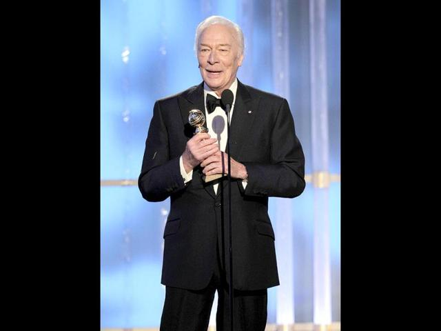 Christopher-Plummer-holds-his-award-after-winning-for-best-performance-by-an-actor-in-a-supporting-role-in-a-motion-picture-for-his-work-on-the-film-Beginners-at-the-69th-Golden-Globe-Awards-in-Beverly-Hills-California-Reuters