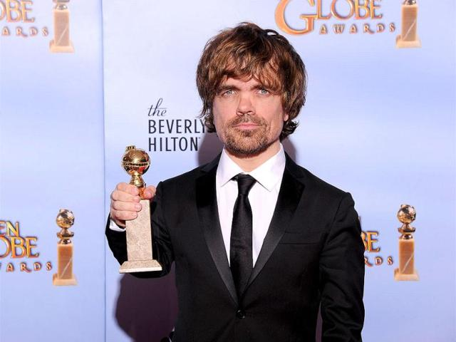 The-winner-for-Best-Performance-by-an-Actor-in-a-Supporting-Role-in-a-Series-Mini-Series-or-Motion-Picture-Made-for-Television-Peter-Dinklage-poses-with-the-trophy-at-the-69th-annual-Golden-Globe-Awards-at-the-Beverly-Hilton-Hotel-in-Beverly-Hills-California-AFP