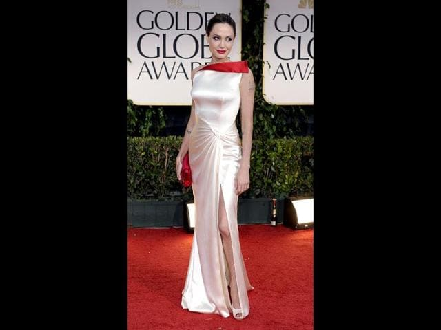 Angelina-Jolie-looked-stunning-in-white-satin-Versace-gown-with-a-hint-of-red-AP