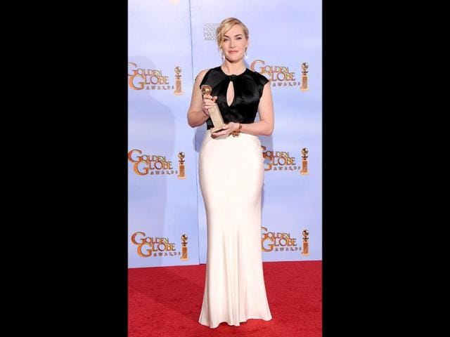 Kate-Winslet-who-took-home-the-Best-Actress-in-a-Mini-series-trophy-for-Mildred-Pierce-turned-out-in-a-black-and-white-Jenny-Packham-gown-AFP