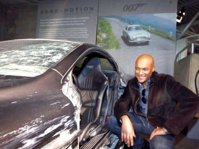 British actor Colin Salmon poses next to a crashed Aston Martin DBS on display at the opening of a press preview of the Bond in Motion exhibition at the Beaulieu National Motor Museum at Brockenhurst in the southern English county of Hampshire. AFP photo