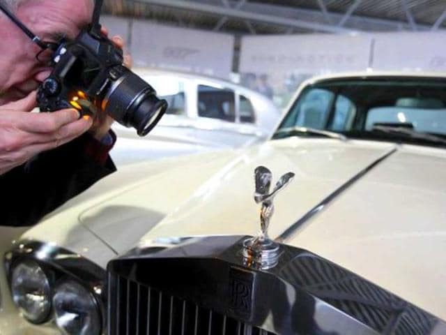 A man photographs a Rolls-Royce Silver Shadow 2 at the opening of a press preview of the Bond in Motion exhibition at the Beaulieu National Motor Museum at Brockenhurst in the southern English county of Hampshire. AFP photo
