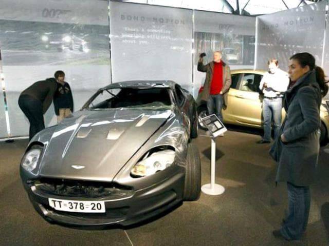 People look at a damaged Aston Martin DBS used in the 2006 James Bond film Casino Royale at the opening of the Bond in Motion exhibition at the Beaulieu National Motor Museum at Brockenhurst in Hampshire. AFP photo