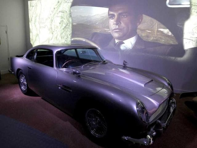 A film clip shows Sean Connery driving the Aston Martin DB5 in the James Bond movie Goldfinger at the opening of the Bond in Motion 50 vehicles in 50 years exhibition at the National Motor Museum in Beailieu, near Southampton, England. AP photo