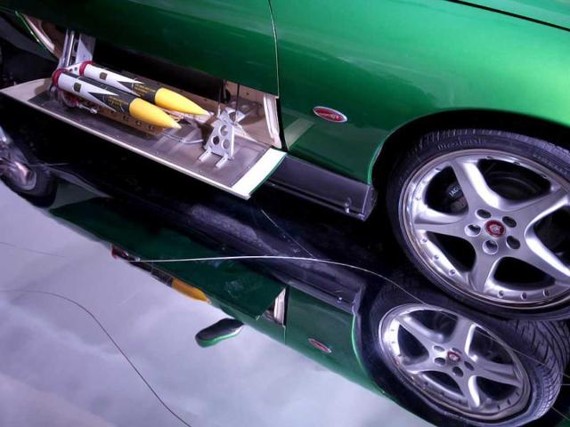 A detail of the green Jaguar XKR Convertible, that was used in the James Bond movie Die Another Day, showing the side pod rockets at the opening of the Bond in Motion 50 vehicles in 50 years exhibition at the National Motor Museum in Beailieu, near Southampton, England. AP Photo