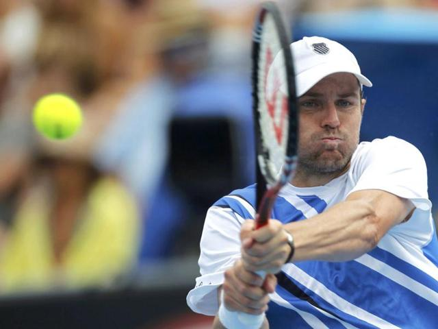 Qualifier Michael Russell shocks top seed Mardy Fish