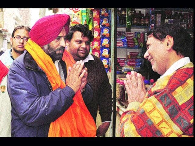 SAD-candidate-and-former-India-hockey-captain-Pargat-Singh-greets-voters-while-campaigning-in-Jalandhar-Cantonment-constituency-Sikander-Singh-Chopra-HT