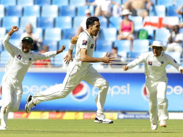 Umar-Gul-center-celebrates-wicket-of-Kevin-Pietersen-on-Day-3-of-the-first-Test-match-in-Dubai-Pak-handed-England-its-first-Test-defeat-in-13-months-with-a-10-wicket-victory-inside-3-days-AP-Photo-Matt-Dunham