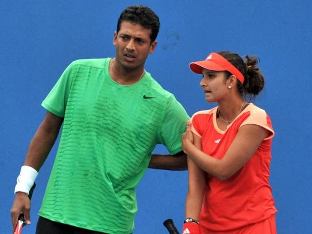 Sania-Mirza--and-Mahesh-Bhupathi-chat-while-playing-against-Natalle-Grandin-of-South-Africa-and-Jean-Julien-Rojer-of-Curacao-in-their-mixed-doubles-match-on-day-five-of-the-2012-Australian-Open-tennis-tournament-in-Melbourne-AFP-Photo-Findlay-Kember