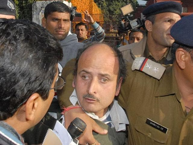 A-man-who-hurled-a-shoe-at-Team-Anna-members-at-a-public-meeting-being-taken-away-by-the-police-in-Dehradun-HT-photo-Rupesh-Kumar