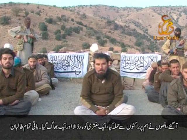 Handcuffed-Pakistani-soldiers-sit-cross-legged-with-two-masked-gunmen-standing-behind-them-in-this-still-image-taken-from-video-released-by-Taliban