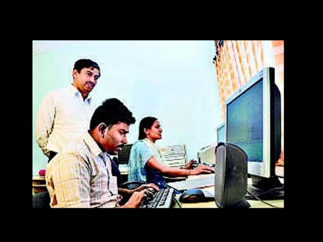 Mahantesh-G-K-standing-has-set-up-a-computer-training-centre-for-the-disabled-Gireesh-GV-HT-Photos