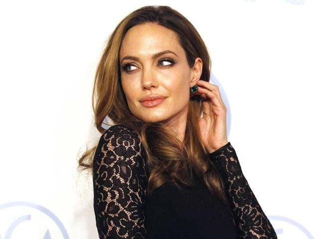 Angelina casts a spell with her signature seductive look.