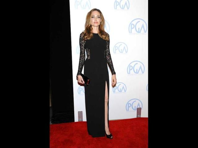 Jolie donned a long black gown with a tantalising slit.