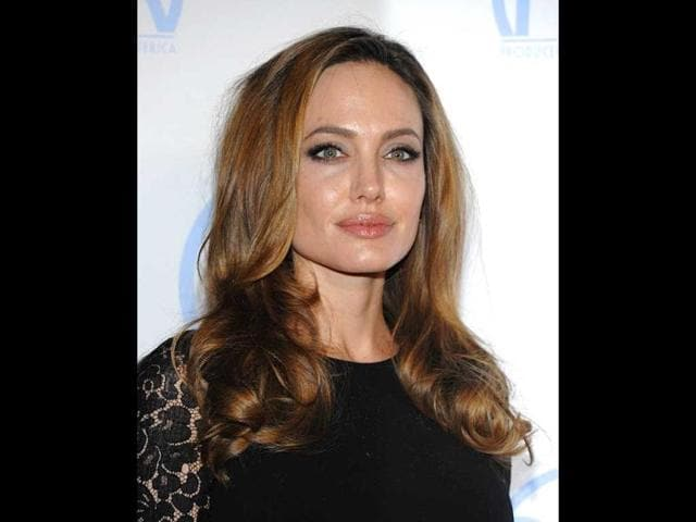 Angelina Jolie looks radiant as ever as she poses for the paparazzi.