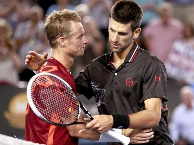 Novak-Djokovic-R-of-Serbia-embraces-Lleyton-Hewitt-of-Australia-after-their-men-s-singles-match-at-the-Australian-Open-tennis-tournament-in-Melbourne-Reuters-Daniel-Munoz