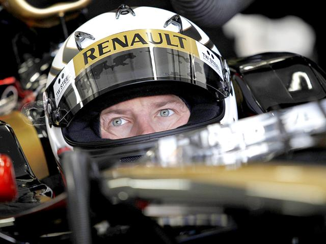 Finland-s-2007-Formula-One-world-champion-Kimi-Raikkonen-sits-in-his-car-before-his-first-run-with-a-Lotus-Renault-Formula-One-car-on-January-23-2012-in-Valencia--AFP-Photo