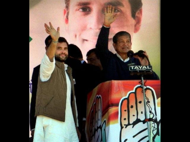 Congress-general-secretary-Rahul-Gandhi-waves-during-an-election-rally-in-a-village-near-Allahabad-PTI-Photo
