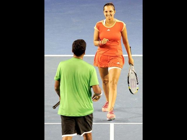 Sania-Mirza-R-celebrates-with-compatriot-Mahesh-Bhupathi-during-their-mixed-doubles-match-against-Liezel-Huber-of-the-US-and-Colin-Fleming-of-Britain-during-the-Australian-Open-tennis-tournament-in-Melbourne-AFP-Photo-William-West